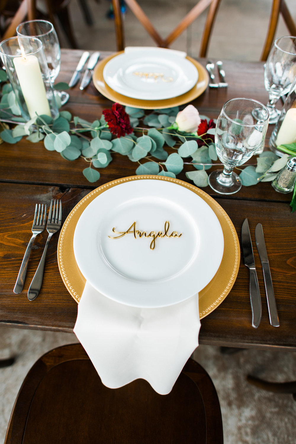 Cursive gold guest names for each place setting