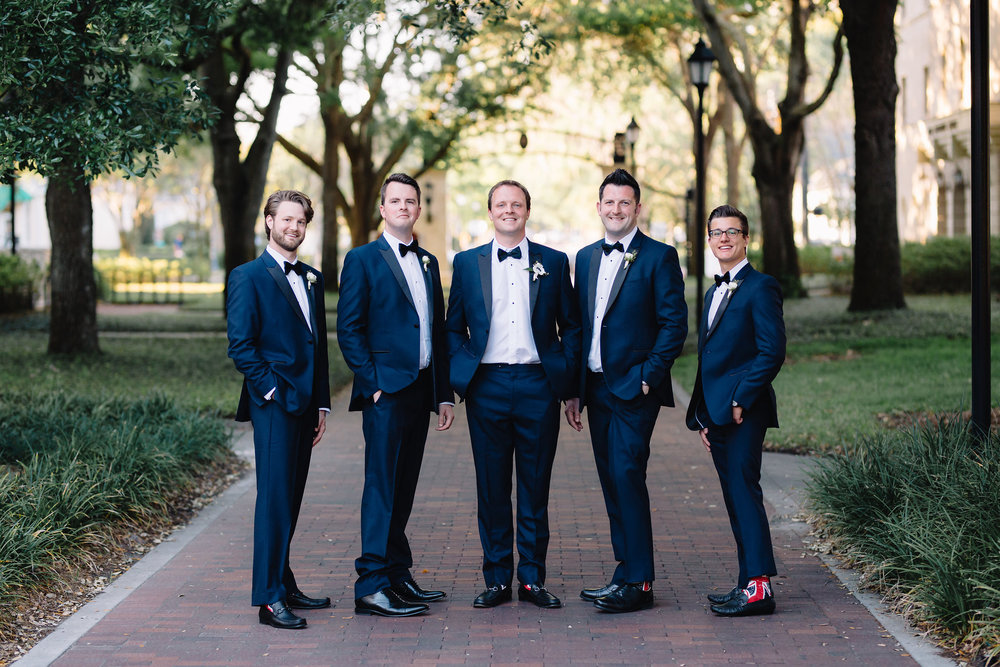 Groom and groomsmen in navy suits