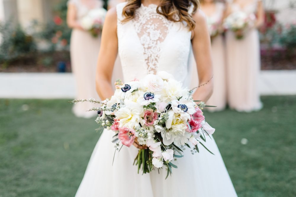 Bridal bouquets of ivory, blush and pink roses with aniomes