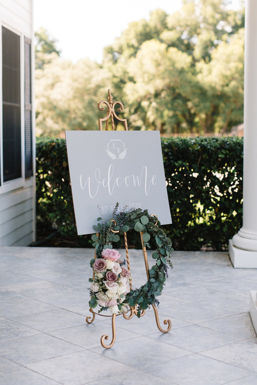 Calligraphy welcome sign with floral & eucalyptus wreath