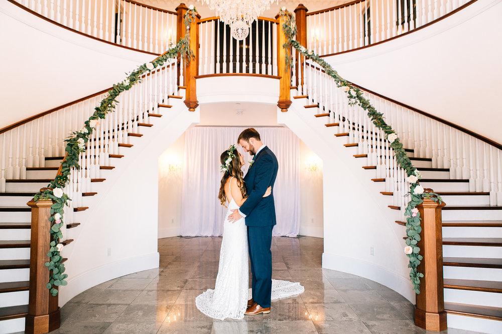 Luxmore Grande Estate bride & groom with garlands on staircase Orlando Wedding Planner
