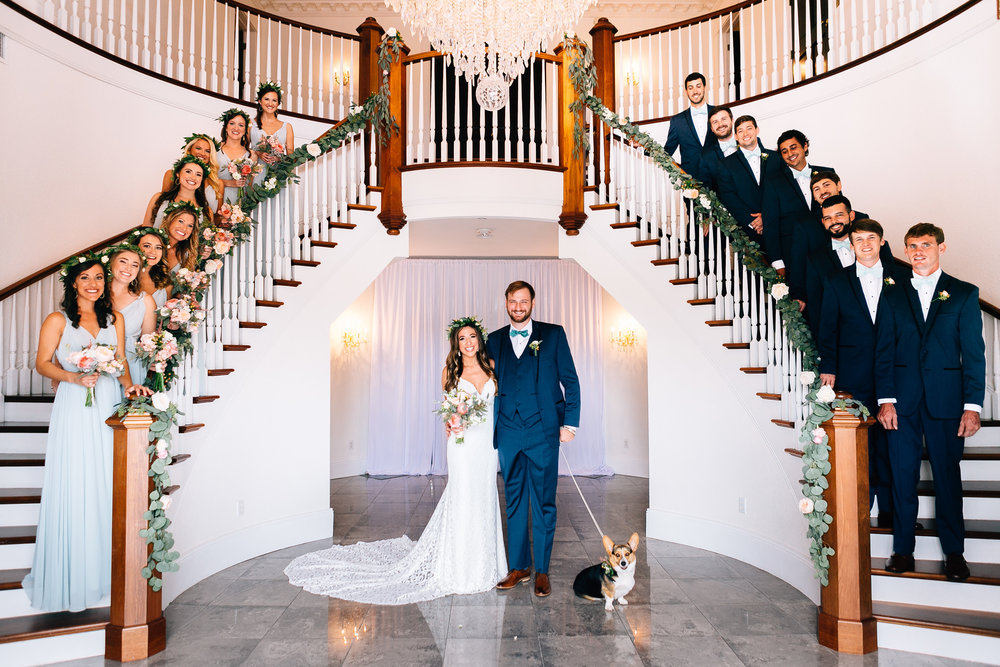 Indoor wedding Luxmore Grande, wedding party on staircase Orlando Wedding Planner Blue Ribbon Weddings