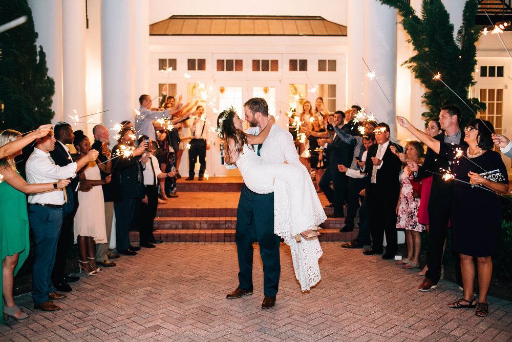 Sparkler exit groom carries bride at Luxmore Grande Estate