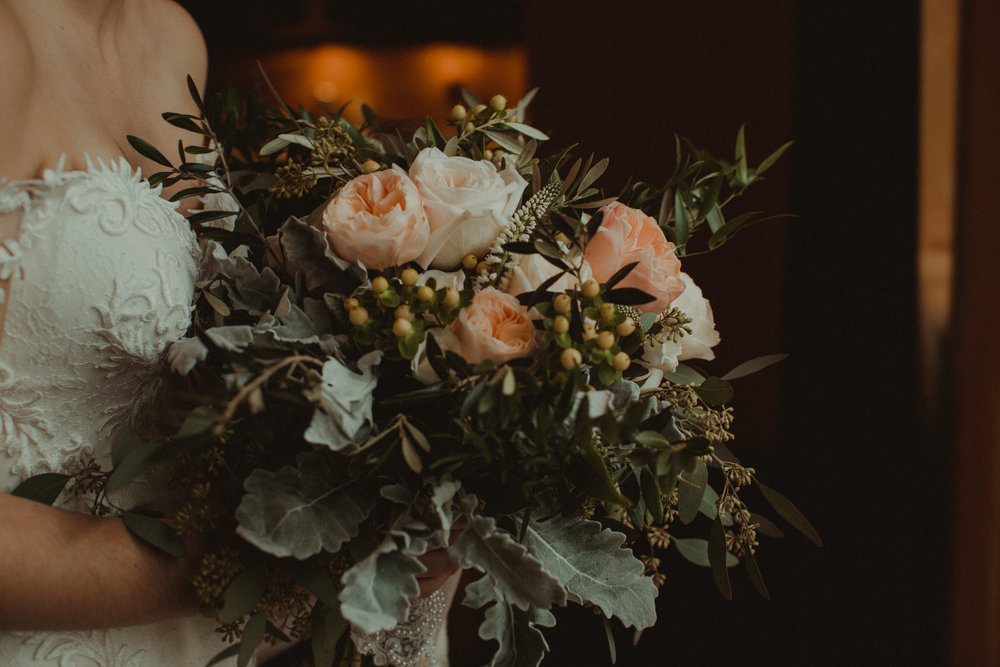 Bridal bouquet with blush juliet roses, ivory garden roses and dusty miller