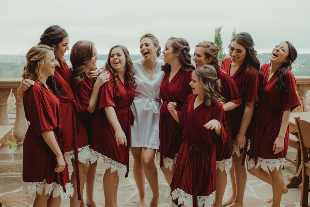 Bride and her maids in their red and lace robes