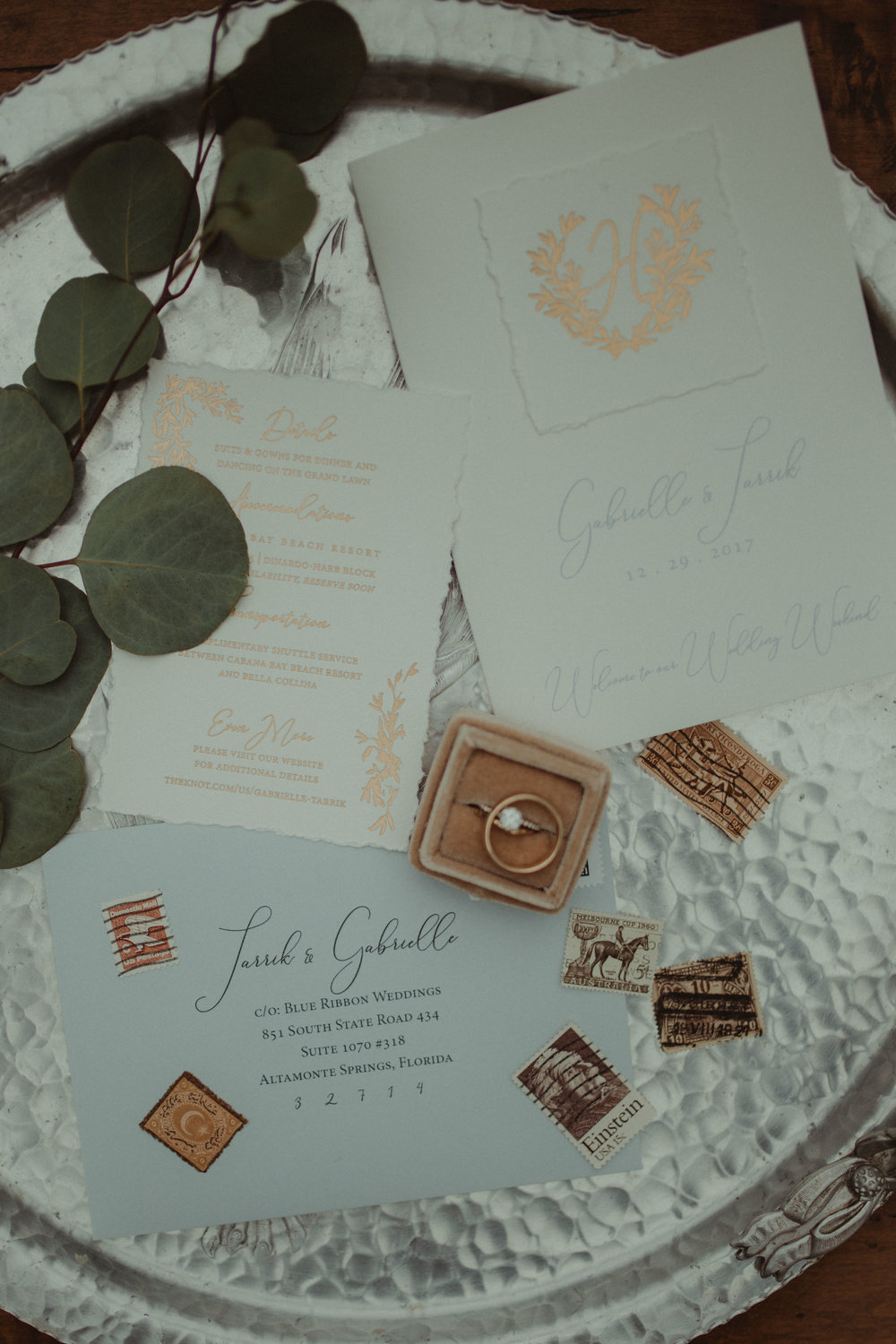Wedding details including invitation and wedding rings