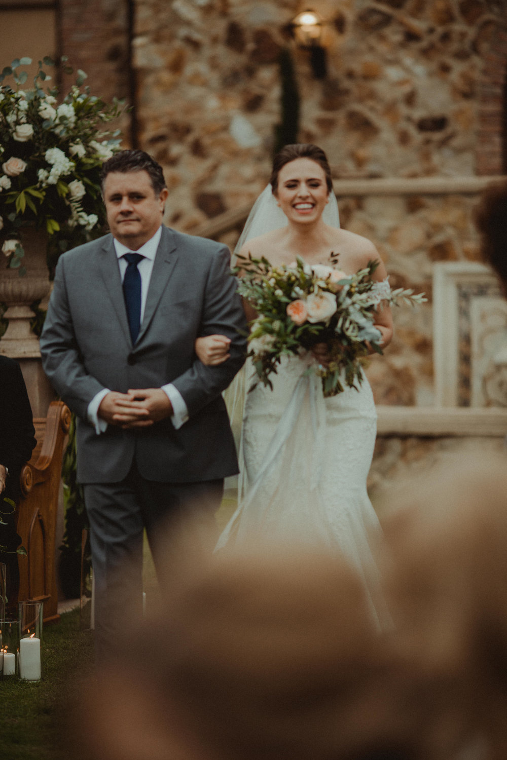 More happiness as the bride is escorted by her father