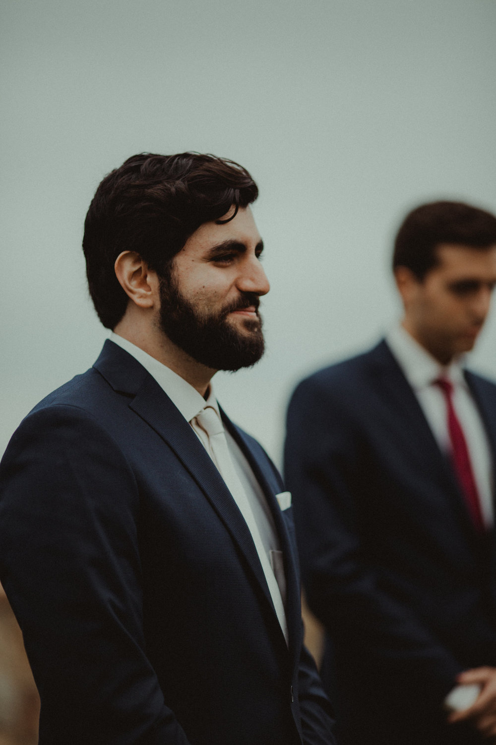 The sweet expression when the groom sees his bride down the aisle
