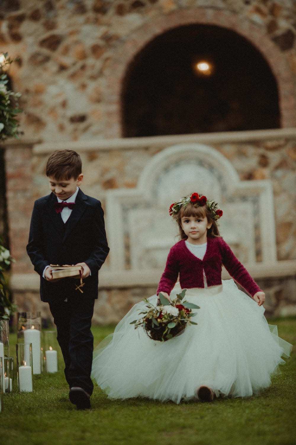 Making their way down the aisle, the ring bearer carried a bible while the flower girl carried her basket