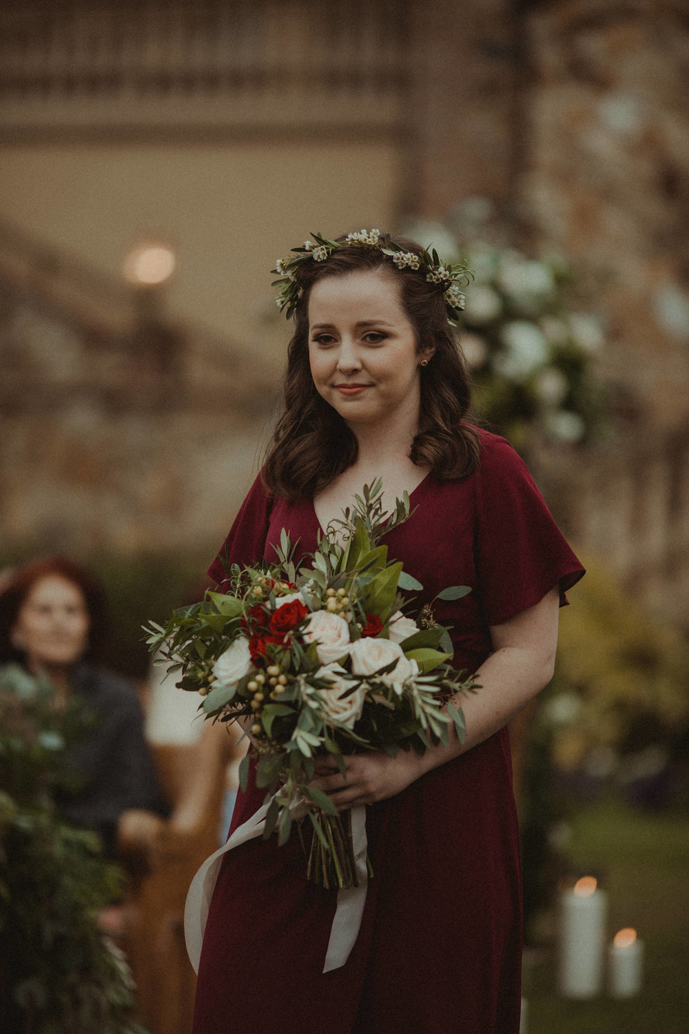 Bridesmaid in Paper Crown gown with flower crown