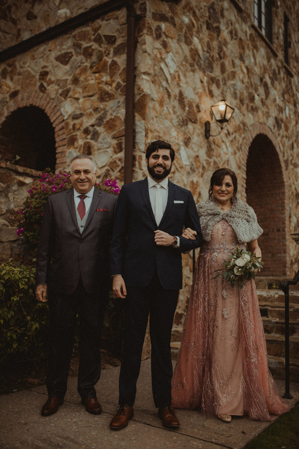 Tarrik and his parents before the wedding ceremony