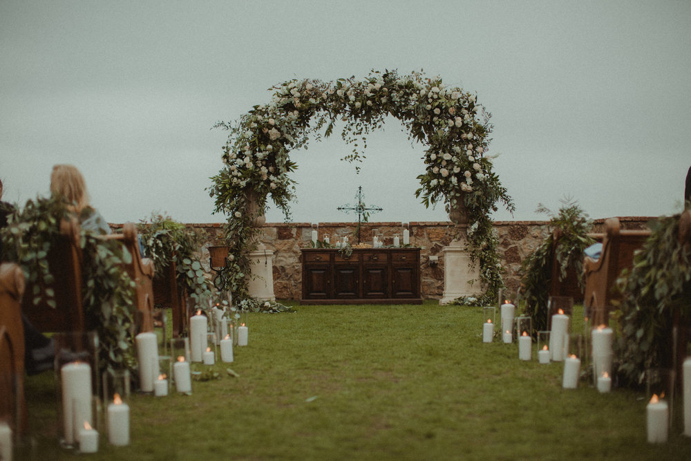 Gorgeous arch with juliet roses by Raining Roses