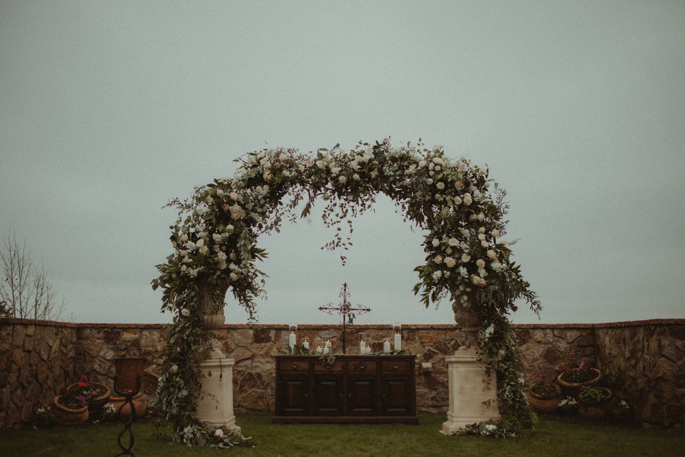 Ceremony floral arch, full of blush and ivory garden roses