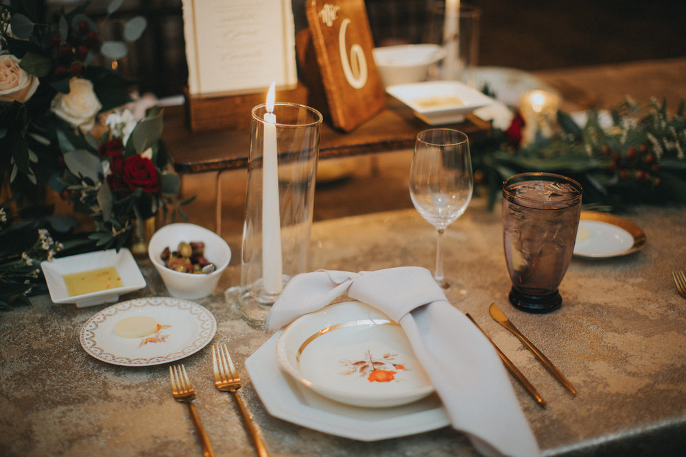 Place setting with specialty dishware and rose gold flatware