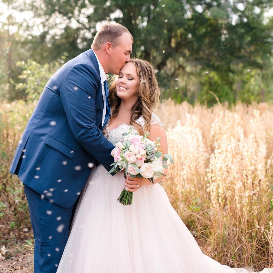 Skyline Ranch wedding in field of wildflowers