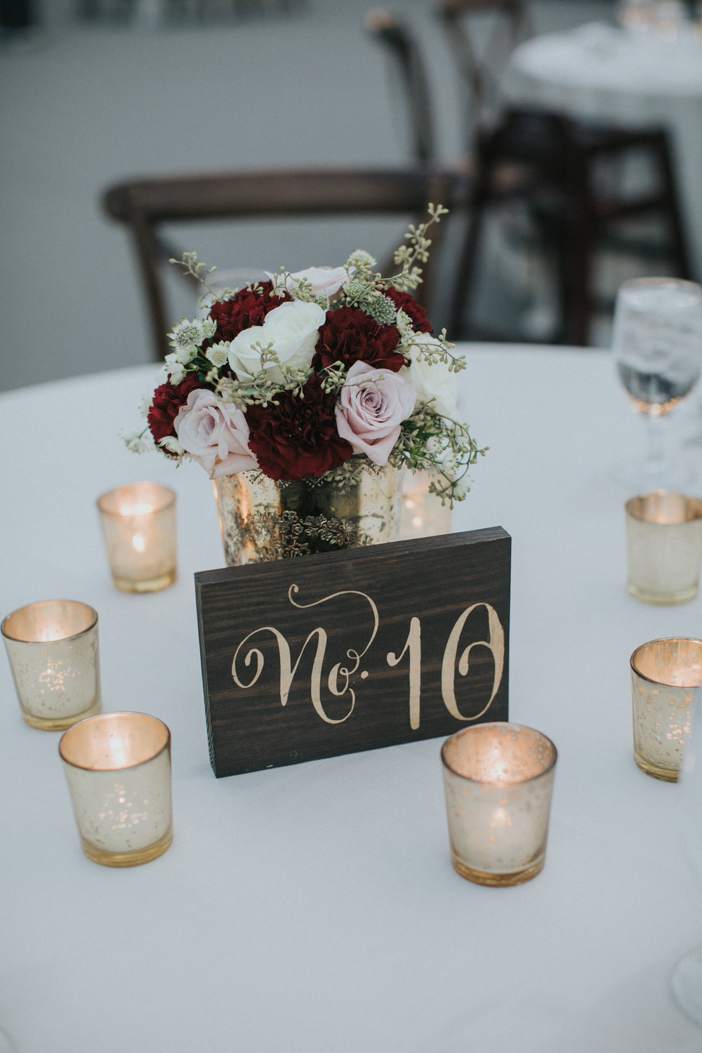 Wooden tables numbers with gold calligraphy