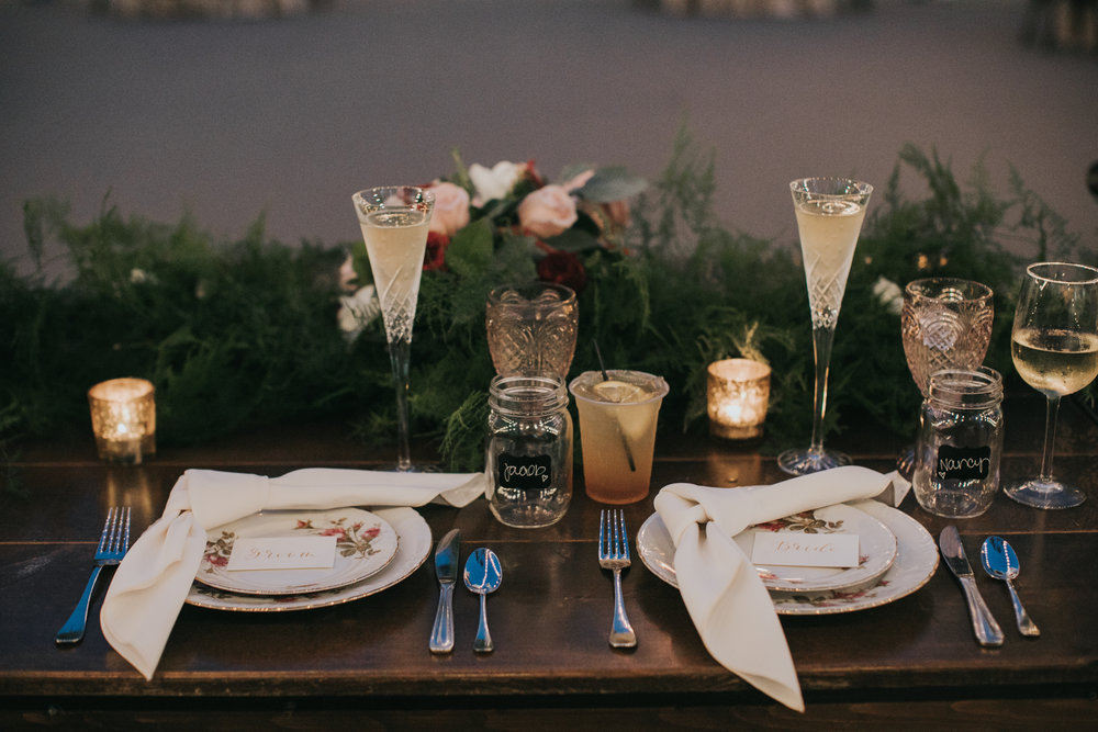 Complete with knotted napkins, crystal flutes and bride/groom name cards