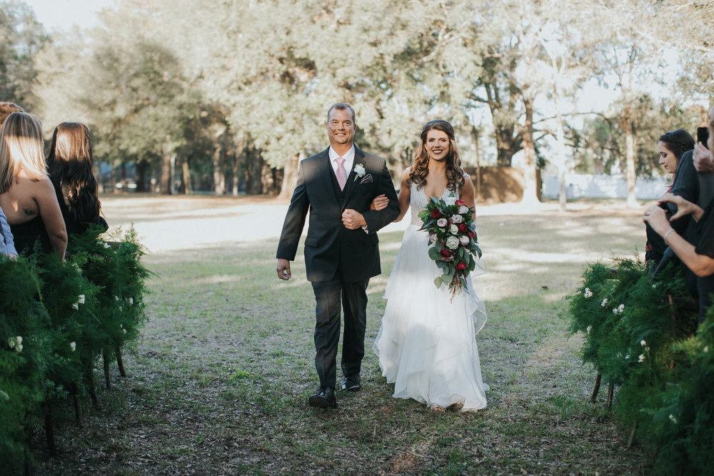 Bride escorted by her Father down the aisle at Arundel Estate