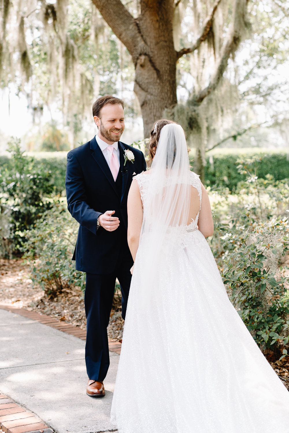 First Look at a Blush & Gold Wedding at Cypress Grove Estate House  Orlando Wedding Florist Bluegrass Chic  Orlando Bridal Salon Calvet Couture  Orlando Wedding Planner Blue Ribbon Weddings  Orlando Wedding Photographer JP Pratt Photography  Wedding Ceremony at Cypress Grove Estate House  Tented Lakeside Wedding Reception at Cypress Grove Estate House