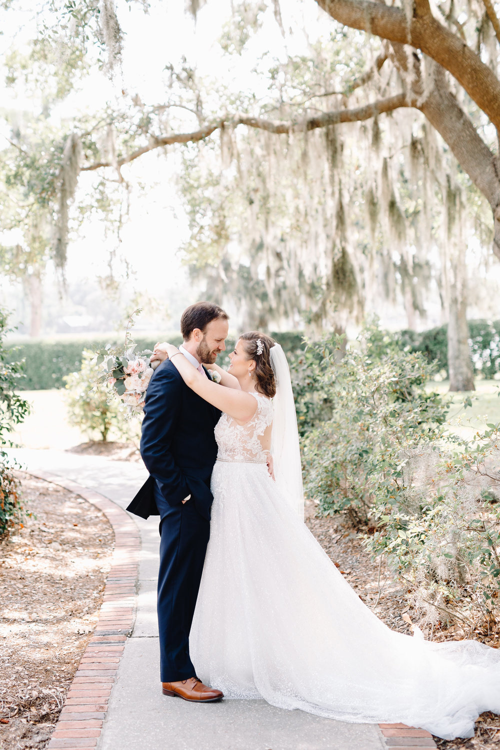 Blush & Gold Wedding at Cypress Grove Estate House  Orlando Wedding Florist Bluegrass Chic  Orlando Bridal Salon Calvet Couture  Orlando Wedding Planner Blue Ribbon Weddings  Orlando Wedding Photographer JP Pratt Photography  Wedding Ceremony at Cypress Grove Estate House  Tented Lakeside Wedding Reception at Cypress Grove Estate House