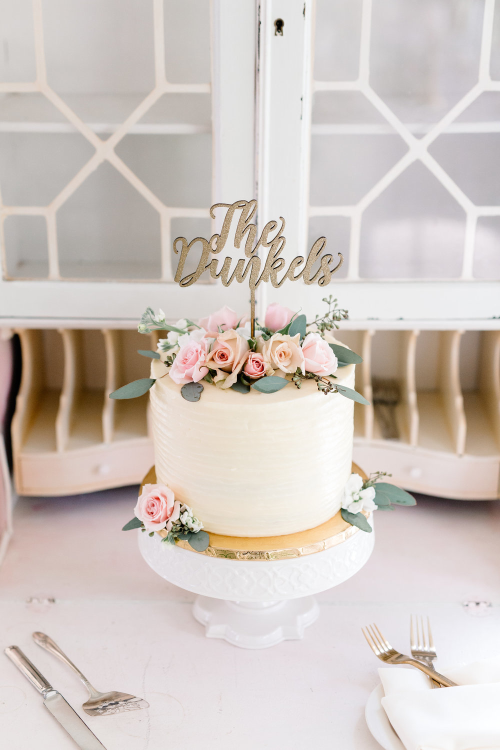 Blush & Gold Wedding Cake at Cypress Grove Estate House  Orlando Wedding Florist Bluegrass Chic  Orlando Wedding Planner Blue Ribbon Weddings  Orlando Wedding Photographer JP Pratt Photography  Wedding Ceremony at Cypress Grove Estate House  Tented Lakeside Wedding Reception at Cypress Grove Estate House