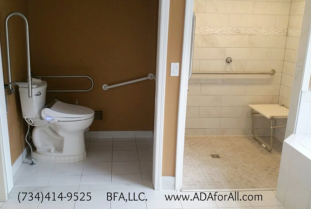 Accessible Bathroom. Roll-in shower with folding bench. ADA toilet with Flip bars and bidet toilet seat.