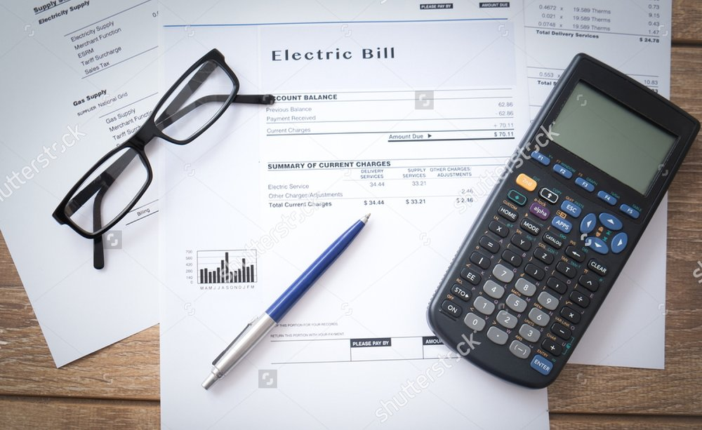 stock-photo-electricity-bill-paper-form-on-the-table-562181419-2.jpg