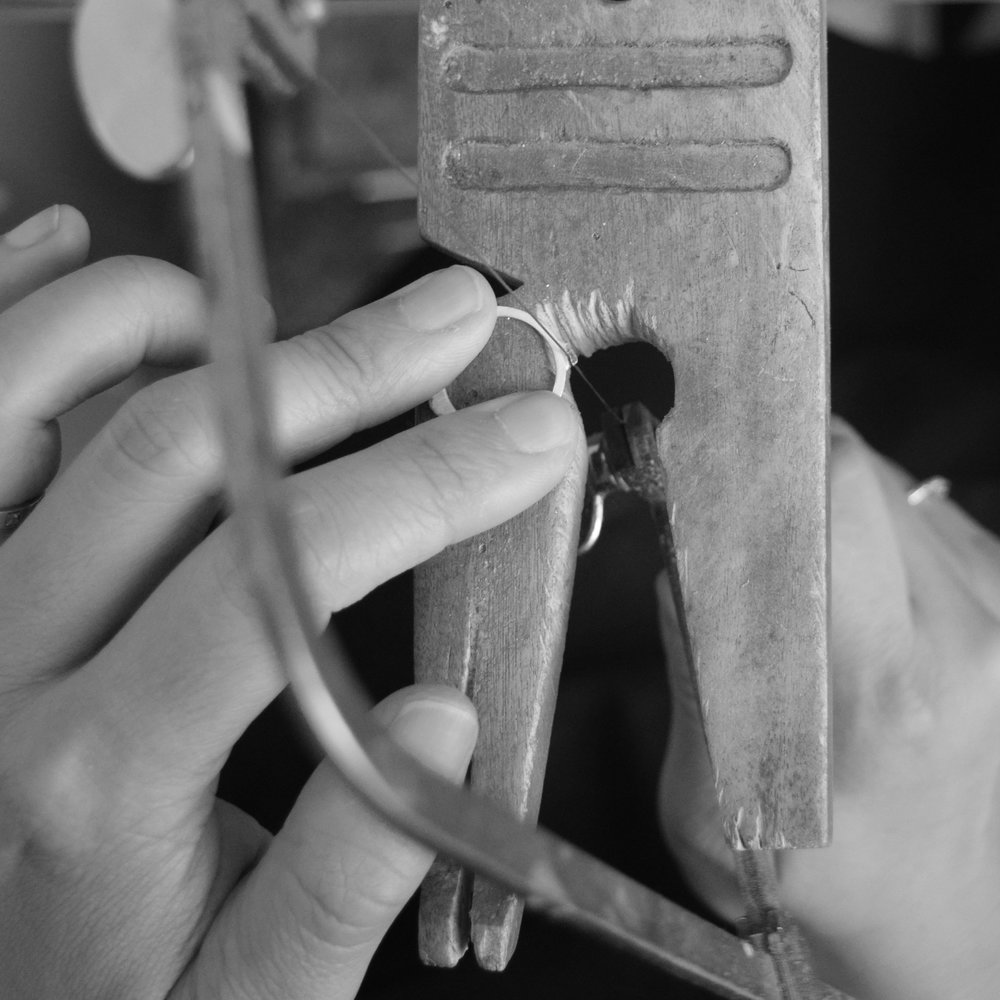 "1.We saw off the ""sprue"" on the casting, which is excess metal that held the ring in place during the casting process."