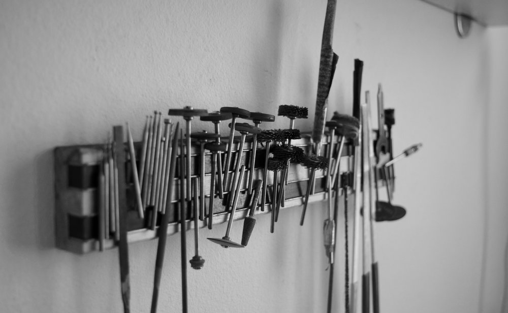 A closer look at our tool bar, filled with different tools for polishing and drilling. Each of our jewelry piece comes into contact with at least a third of them!