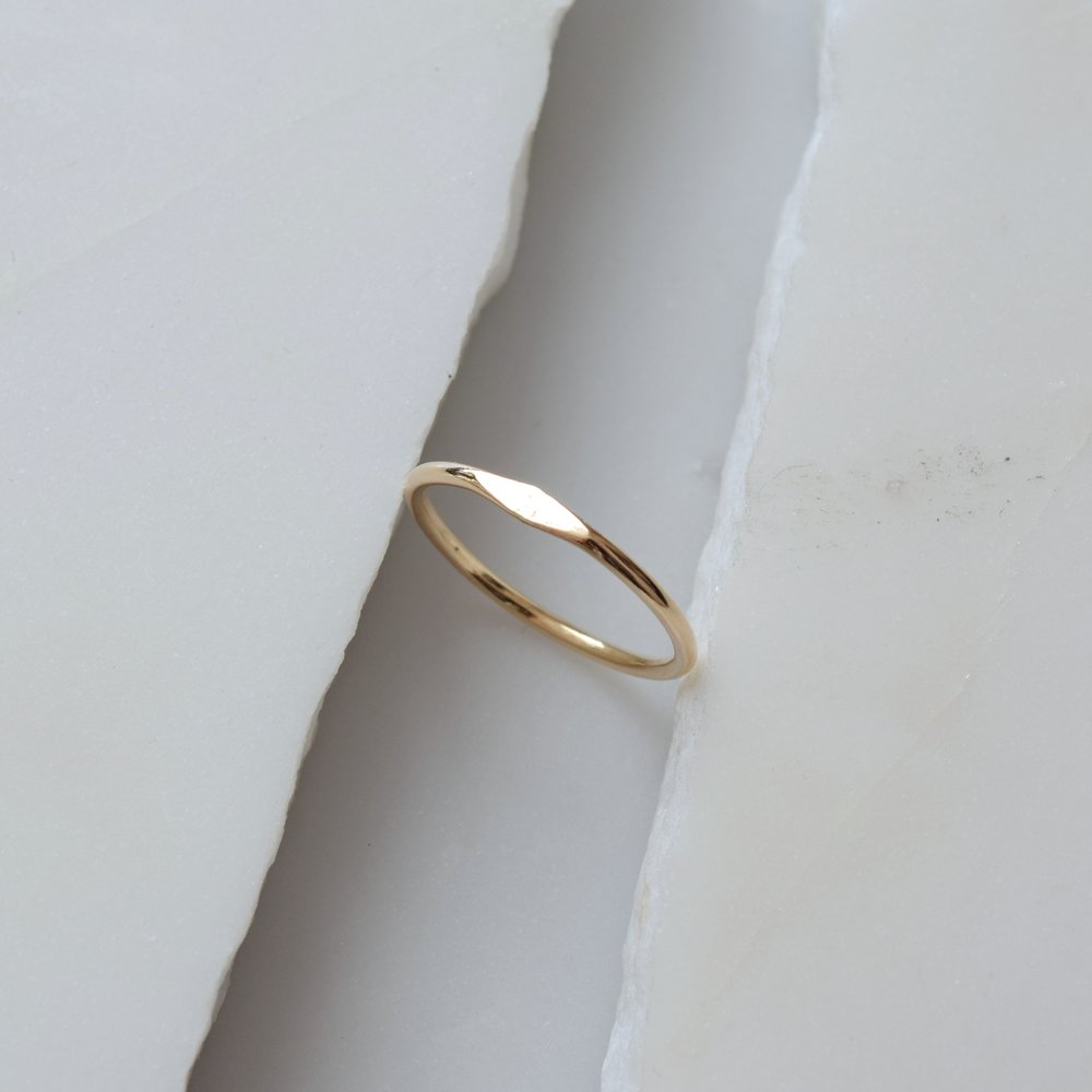 This solid gold band, because she has a heart of gold.