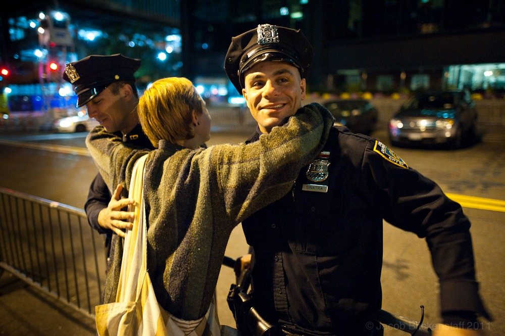 #occupywallstreet Castilleja Kuzis, 18, of Idaho, hugs two patrolling officers in Liberty Plaza. 10/6/2011
