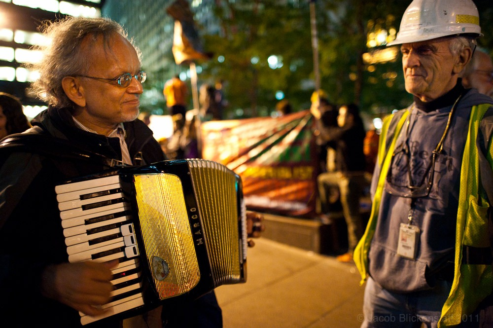 #occupywallstreet An accordionist (and retired lawyer) played Yiddish music at the request of a Freedom Tower construction worker. 10/5/11