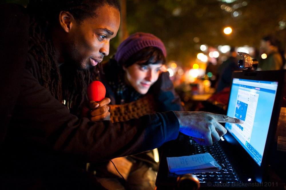 #occupywallstreet Hero Vincent and Monica Lopez broadcasting live from the media center in Liberty Plaza.