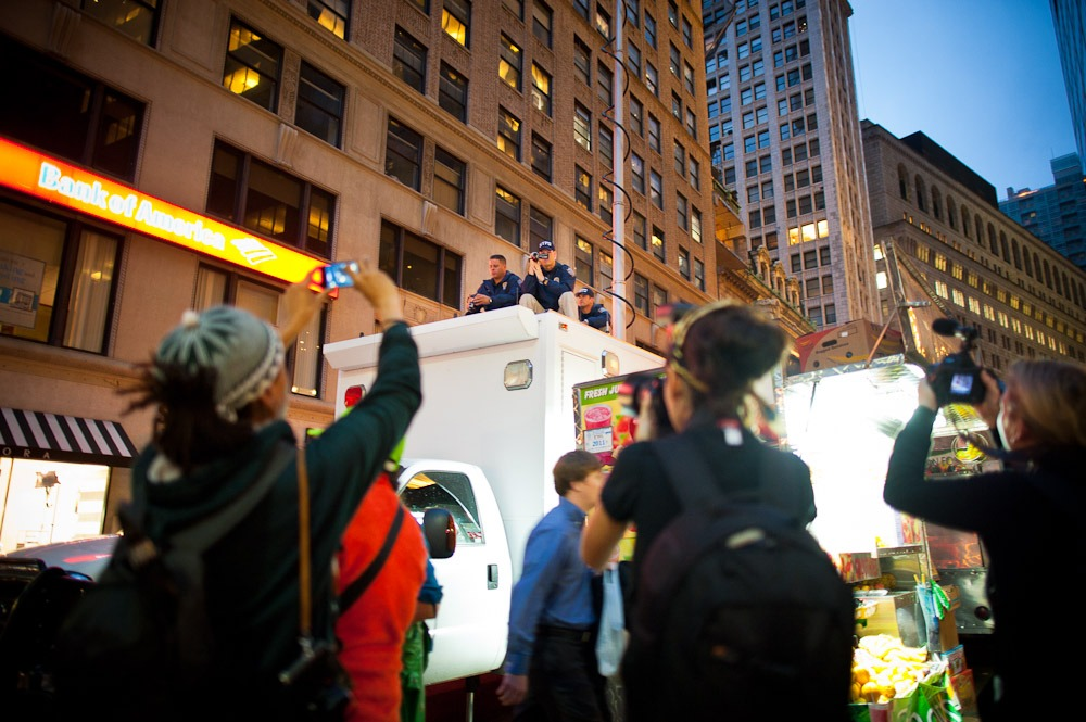 #occupywallstreet: Police videotape the gathering at Zuccotti Park as protestors videotape the police.