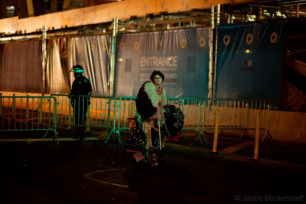 #occupywallstreet A protestor leaves Zuccotti Park with her belongings early in the morning.