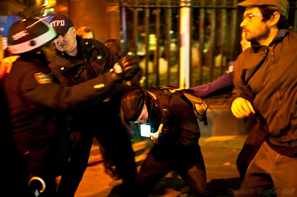 #occupywallstreet A protestor scuffled with police near Trinity Church.