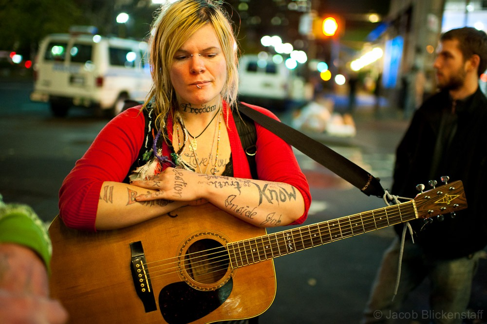 #occupywallstreet A protestor, Kanaska, with guitar waited near Broadway and Vesey Streets after the eviction.