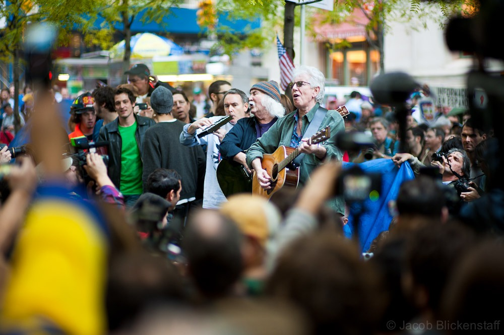 David Crosby and Graham Nash performing to a packed crowd at Zuccotti Park. #occupywallstreet