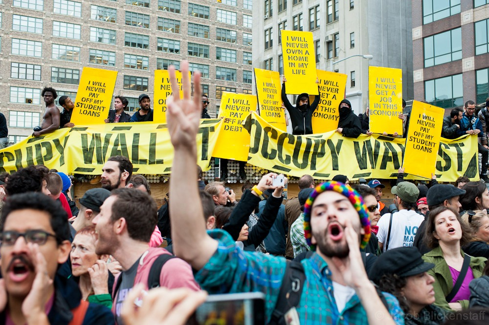 #occupywallstreet General Assembly at Duarte Square off of Canal Street. Some protestors scaled the wall in order to occupy a lot owned by Trinity Church.