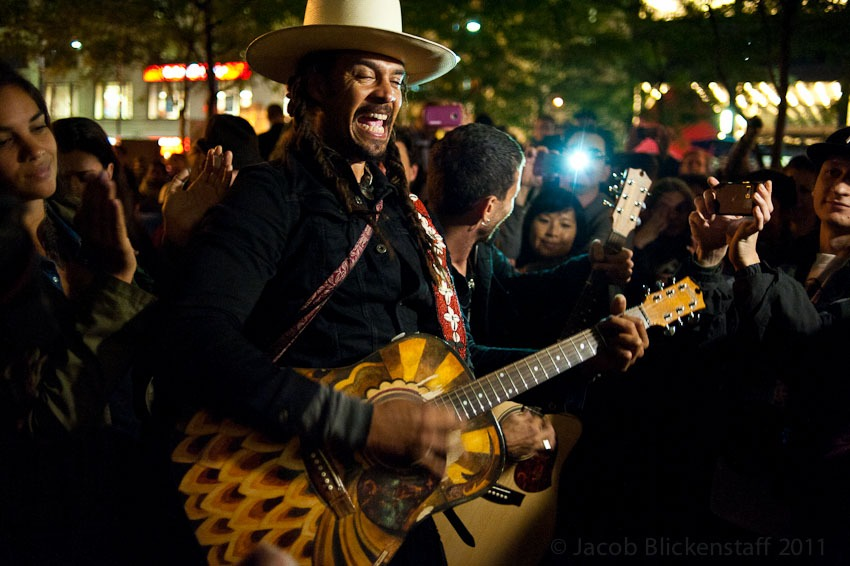 Michael Franti sang songs at Zuccatti Park / Liberty Plaza in the evening. 10/4/11