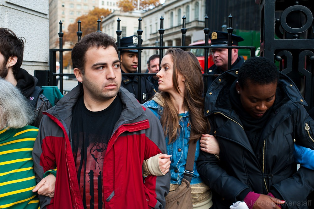 #occupywallstreet Protestors formed a human chain to block access to Mayor Bloomberg's press conference at City Hall.