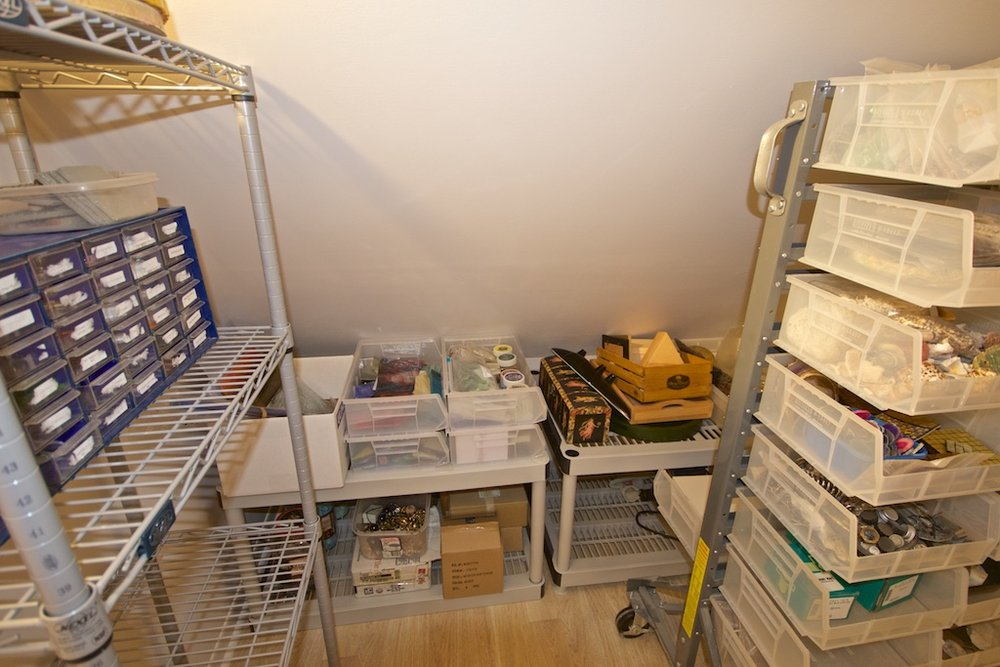 Inside the closet. I used parts of shelving to maximize storage along the low, angled wall.