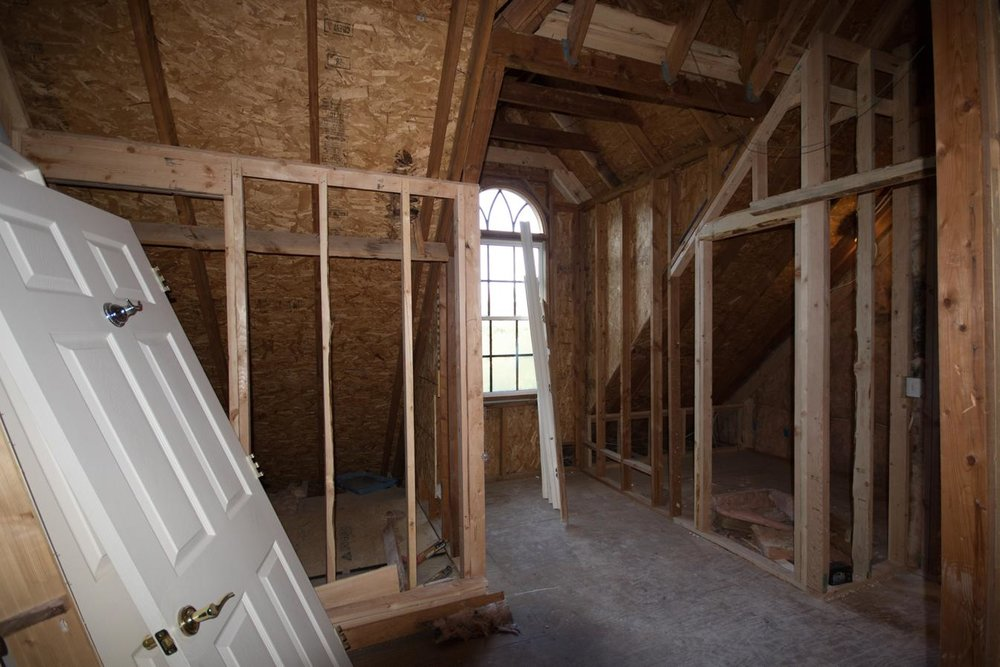 Just after construction began: Two closets on either side of the dormer window are taking shape. The attic door to the hall is off to the extreme right.
