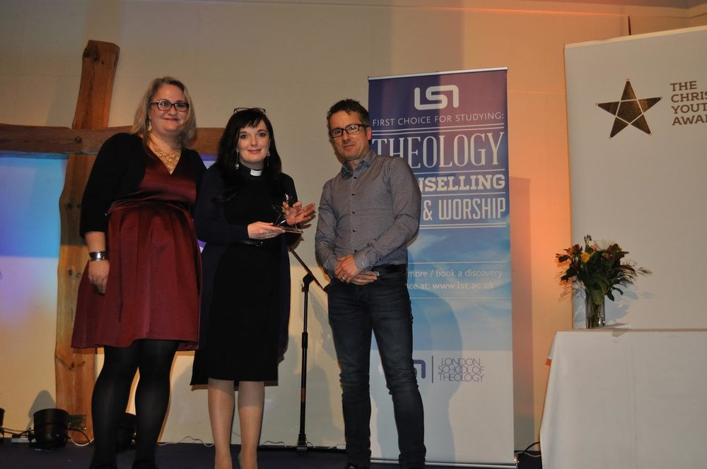 Gemma Dunning and Revd Sally Hitchiner from Diverse Church receiving their award from Robin Barden
