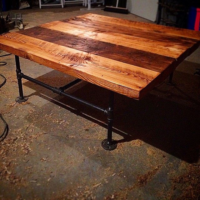 Reclaimed barnwood coffee table on plumbers pipe base