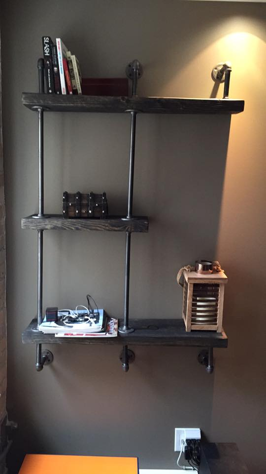Reclaimed barnboard and plumbes pipe shelving unit