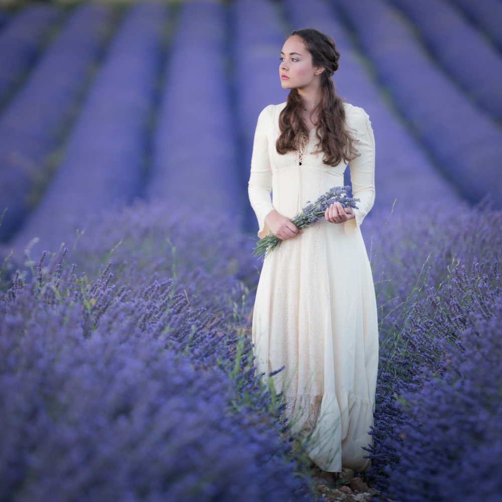 Portrait of a beautiful young women in the Provence lavender fields