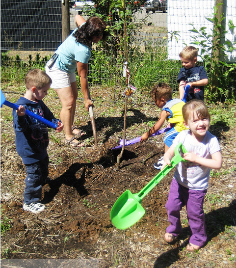 Our former preschool planting a tree on Arbor Day