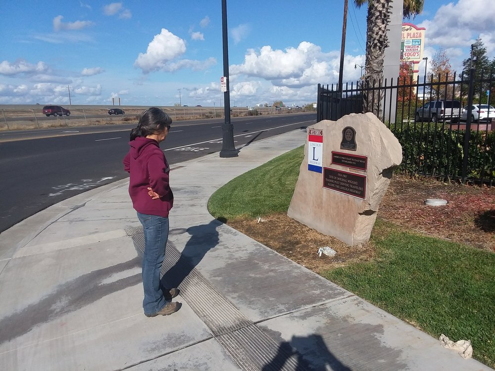 Monica checking out the monument at Wiggins Trading Post site, Lathrop, CA.