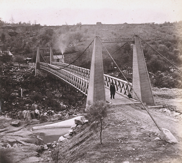 Rattlesnake Bar Bridge, 1860 or 1870's. Notice the young child just to the left of the man standing.